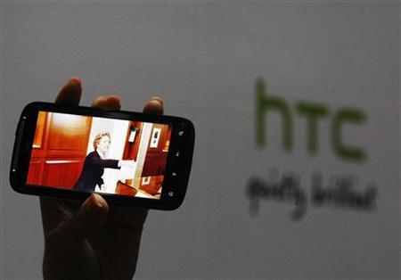 A new HTC Android-based smartphone ''Sensation'' is displayed during a news conference for the launch of the product in Taipei May 27, 2011. REUTERS/Pichi Chuang