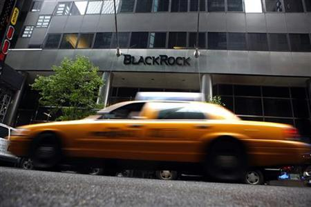 A taxi passes a BlackRock building in New York June 12, 2009. REUTERS/Eric Thayer