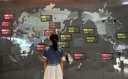 A girl looks at a board showing global stock indices at the Taiwan Stock Exchange in Taipei, August 11, 2011. REUTERS/Pichi Chuang
