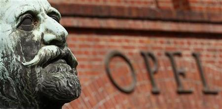 The statue of German car manufacturer Opel founder, Adam Opel is seen in front of the main gate at the headquarters in Ruesselsheim, 20km from Frankfurt, June 10, 2011. REUTERS/Kai Pfaffenbach