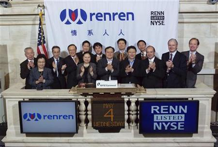 China's Renren Inc. Chairman and Chief Executive Officer, Joseph Chen (C) is joined by executives and guests as he rings the opening bell at the New York Stock Exchange, May 4, 2011. REUTERS/Adam Au - NYSE Euronext/Handout