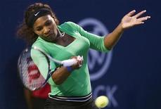 <p>Serena Williams of the US returns a shot to Lucie Safarova of The Czech Republic during their quarter-final match at the Rogers Cup women's tennis tournament in Toronto, August 12, 2011. REUTERS/Mark Blinch</p>