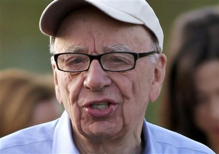 Rupert Murdoch, Australian-American media mogul and the Chairman and CEO of News Corporation, speaks briefly to the media as he arrives at the Sun Valley Inn before the start of the second day of the Allen and Company Sun Valley Conference in Sun Valley, Idaho in this July 7, 2011 file photo. REUTERS/Anthony Bolante/Files