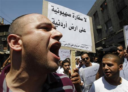Anti-government protesters shout slogans during a demonstration against what they say are worsening political and economic conditions, after Friday prayers in Amman August 12, 2011. REUTERS/Ali Jarekji