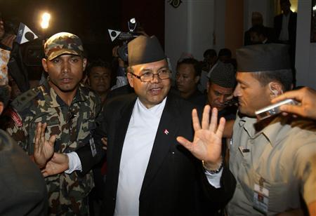 Nepalese Prime Minister Jhalanath Khanal leaves after submitting his resignation to President Ram Baran Yadav at the president's quarters in Kathmandu August 14, 2011. REUTERS/Navesh Chitrakar