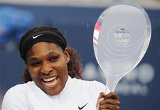 <p>Serena Williams of the U.S. holds the trophy after defeating Samantha Stosur of Australia during their finals match at the Rogers Cup women's tennis tournament in Toronto August 14, 2011. REUTERS/Mark Blinch</p>