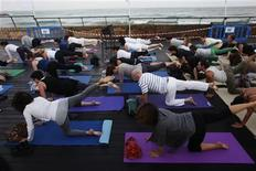 "<p>People practice yoga at the Tel Aviv port, as part of the ""White Night"" festival early July 1, 2011. REUTERS/Nir Elias</p>"