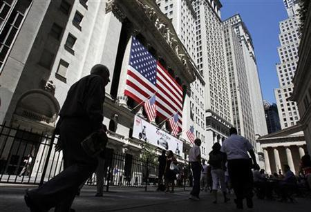 People walk past the New York Stock Exchange in New York August 12, 2011. REUTERS/Jessica Rinaldi
