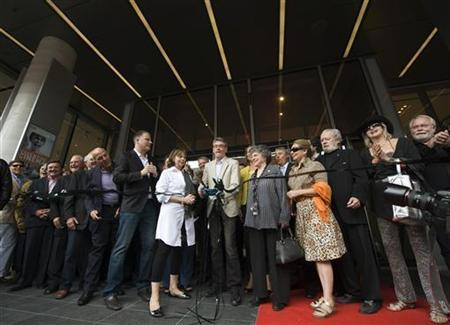 Piers Handling (C), the director and CEO of Toronto International Film Festival (TIFF), cuts the ribbon at the opening of the TIFF Bell Lightbox film complex during the 35th Toronto International Film Festival September 12, 2010. REUTERS / Adrien Veczan