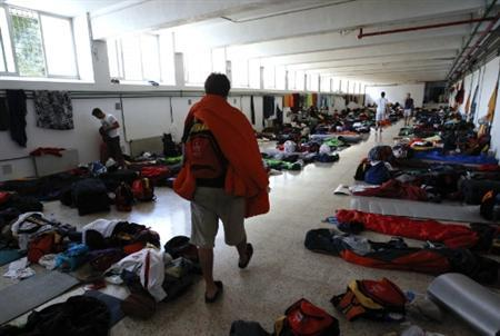 Pilgrims walk inside a school that is hosting them on the second day of the World Youth Day meeting in Madrid August 17, 2011. REUTERS/Andrea Comas
