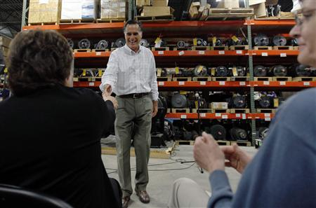 Republican presidential candidate Mitt Romney shakes hands with employees during a visit to Stanley Elevators in Merrimack, New Hampshire August 16, 2011. REUTERS/Brian Snyder