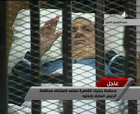 Former Egyptian President Hosni Mubarak gestures in the courtroom during his trial at the police academy in Cairo in this August 15, 2011 still image taken from video. REUTERS/Egypt TV via Reuters TV