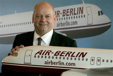 File picture shows Joachim Hunold, CEO of German Air Berlin airline as he poses beside a scale model of an airplane before the company's annual news conference in Berlin March 27, 2007. REUTERS/Arnd Wiegmann/File