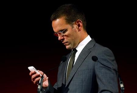 BSkyB Chairman James Murdoch, who is also head of News Corp in Europe and Asia, checks his mobile phone before rehearsals for his James MacTaggert Memorial lecture as part of the Media Guardian Edinburgh International TV Festival in Edinburgh, Scotland August 28, 2009. REUTERS/David Moir