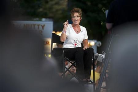 Former Alaksa Governor Sarah Palin speaks during a television appearance at the Iowa State Fair in Des Moines, Iowa August 12, 2011. REUTERS/Daniel Acker