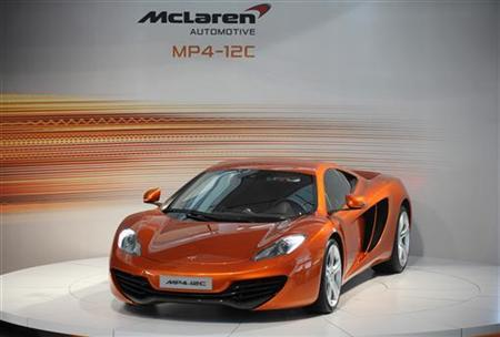 The new McLaren Automotive MP4-12C road car is unveiled at the McLaren Technology centre in Woking, southern England March 18, 2010. REUTERS/Kieran Doherty
