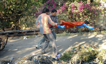 Crew members prop up Shafiq Sheikh, in a superman outfit, while shooting for the film ''Ye Hai Malegaon Ka Superman'' in this file photo. REUTERS/Handout