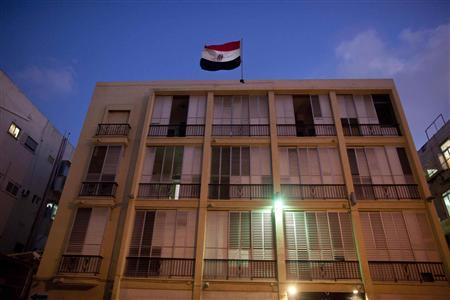 The Egyptian national flag can be seen on the roof of the Egypt embassy in Tel Aviv August 20, 2011. REUTERS/ Nir Elias