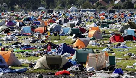 An empty camping site is seen after people left the outdoor Belgian pop festival Pukkelpop near Hasselt August 19, 2011. REUTERS/Laurent Dubrule