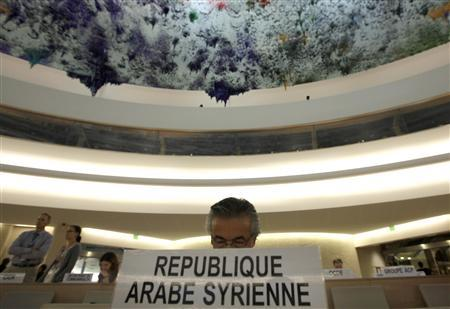 Syria's Ambassador to the United Nations Faysal Khabbaz Hamoui reads documents as he awaits the start of the special session of the United Nations Human Rights Council on the situation in Syria, in Geneva, August 22, 2011. REUTERS/Denis Balibouse
