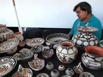 <p>Robert Tenorio displays his Santa Domingo Pueblo pottery at the Santa Fe Indian Market in Santa Fe, New Mexico, August 20, 2011. REUTERS/Mary Caperton Morton/Handout</p>