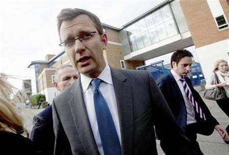 Andy Coulson, the former spokesman for Britain's Prime Minister David Cameron, leaves a police station after being bailed, in South London, July 8, 2011. REUTERS/Olivia Harris