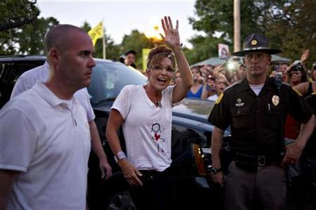 Former Alaksa Governor Sarah Palin greets guests following a television appearance at the Iowa State Fair in Des Moines, Iowa August 12, 2011. REUTERS/Daniel Acker