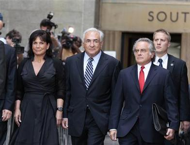 Former IMF chief Dominique Strauss-Kahn and his wife Anne Sinclair depart the Manhattan State Supreme Courthouse after a hearing dismissing the case against him in New York, August 23, 2011. REUTERS/Lucas Jackson