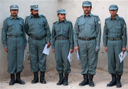 Graduate patrol men stand in line at the Helmand Police training centre near Lashkar Gah in this December 6, 2010 file photo. REUTERS/Leon Neal/Pool/Files