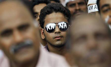A supporter of social activist Anna Hazare wears sunglasses bearing his name, on the seventh day of Hazare's fast at Ramlila grounds in New Delhi August 22, 2011. REUTERS/Adnan Abidi