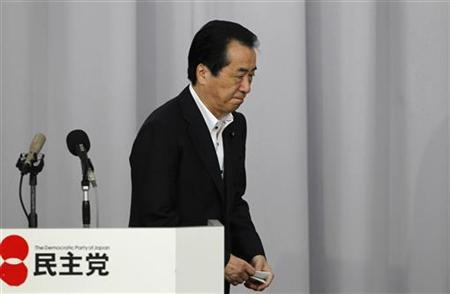 Japan's Prime Minister Naoto Kan leaves from the podium at a general meeting of his ruling Democratic Party of Japan (DPJ) lawmakers at the parliament building in Tokyo August 26, 2011. REUTERS/Toru Hanai