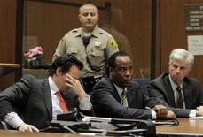 <p>Doctor Conrad Murray (C), the late Michael Jackson's personal physician, sits with his lawyers Edward Chernoff (L) and Michael Flanagan during his arraignment on a charge of involuntary manslaughter in the pop star's death, in Los Angeles, California, January 25, 2011. REUTERS/Pool/Irfan Khan</p>