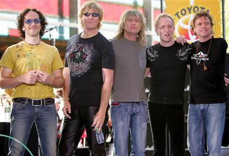 British rock band Def Leppard pose for a photo after their performance live on NBC's 'Today' show in New York May 27, 2005. REUTERS/Albert Ferreira