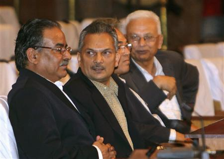 United Communist Party of Nepal (Maoist) prime ministerial candidate Dr. Baburam Bhattarai (2nd L) and party chairman Pushpa Kamal Dahal (Prachanda) are seen during the prime ministerial election in Kathmandu August 28, 2011. REUTERS/Navesh Chitrakar