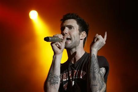 Singer Adam Levine from the band Maroon 5 performs on stage during their concert in Taipei May 19, 2011. REUTERS/Pichi Chuang
