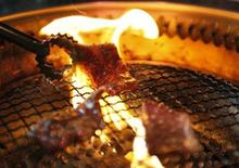 <p>Beef is grilled in Yokohama, south of Tokyo in this July 27, 2011 file photo. REUTERS/Yuriko Nakao</p>