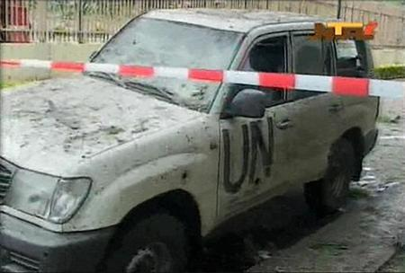 A damaged U.N. vehicle is seen after a bomb blast at the United Nations offices in the Nigerian capital of Abuja, August 26, 2011. REUTERS/NTA via Reuters TV