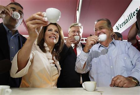 Republican presidential candidate and Minnesota Congresswoman Michelle Bachmann enjoys a Cuban coffee at Cafe Versailles in Miami's Little Havana with owner Felipe Valls (R), in Miami, August 29, 2011. REUTERS/Hans Deryk