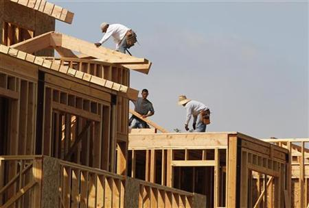 Construction workers are shown on a residential housing work site in Burbank, July 27, 2011. REUTERS/Fred Prouser