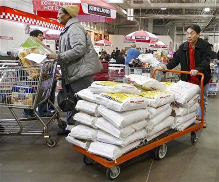 Shoppers push carts in Costco in Fairfax, Virginia, January 7, 2010. REUTERS/Larry Downing