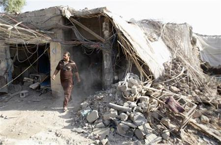 A resident inspects the site of a bomb attack in Basra, 420 km (260 miles) south of Baghdad August 26, 2011. REUTERS/Atef Hassan