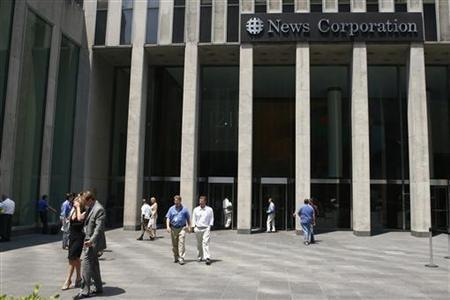People leave the News Corporation building in New York, June 26, 2007. REUTERS/Keith Bedford
