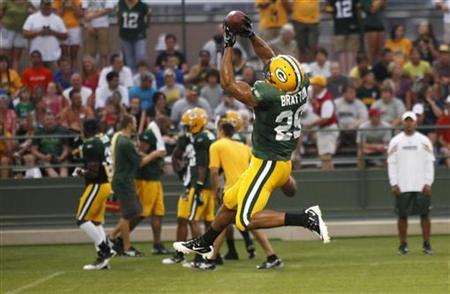 Super Bowl Champions Green Bay Packers' Anthony Bratton catches a ball during NFL training camp practice at the Ray Nitschke field in Green Bay, Wisconsin, August 1, 2011. REUTERS/Darren Hauck