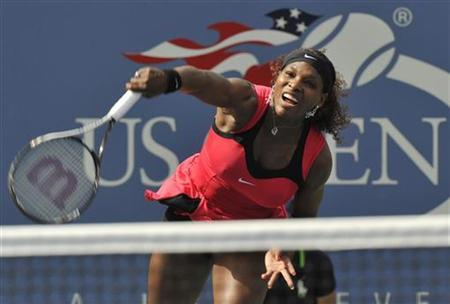 Serena Williams of the U.S. hits a serve to Michaella Kajicek of the Netherlands during their match at the U.S. Open tennis tournament in New York, September 1, 2011. REUTERS/Ray Stubblebine