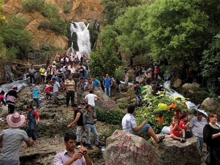 Residents visit Ahmed Awa tourist resort, known for its waterfalls in Sulaimaniya province, 260 km (160 miles) northeast of Baghdad July 22, 2011. REUTERS/Jamal Penjweni