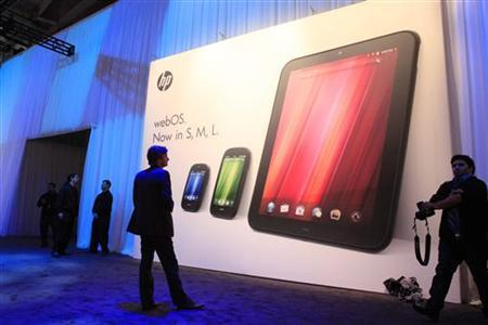 The poster showing all three new HP Palm devices, the Veer (L), the Pre3 (C) and the TouchPad is displayed following a media presentation on the company's web OS at the Herbst Pavilion at the Fort Mason Center in San Francisco Februrary 9, 2011. REUTERS/Beck Diefenbach