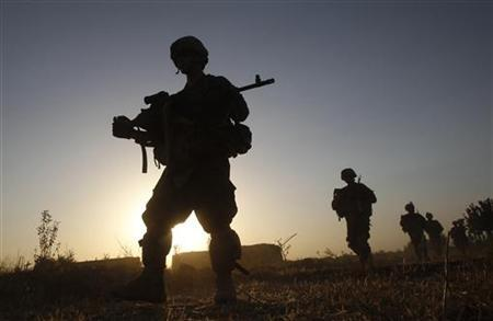 US army soldiers from Charlie company 4th platoon, 1st brigade 3-21 infantry, patrol in the village of Chariagen in the Panjwai district of Kandahar province southern Afghanistan, June 22 , 2011. REUTERS/Baz Ratner
