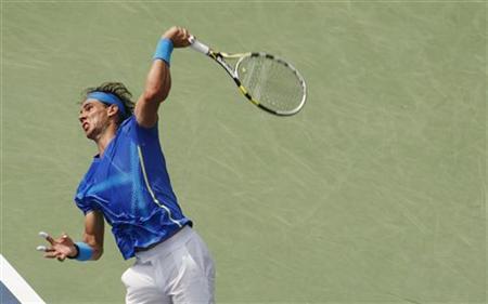 Rafael Nadal of Spain serves to David Nalbandian of Argentina during their match at the U.S. Open tennis tournament in New York, September 4, 2011. REUTERS/Eduardo Munoz