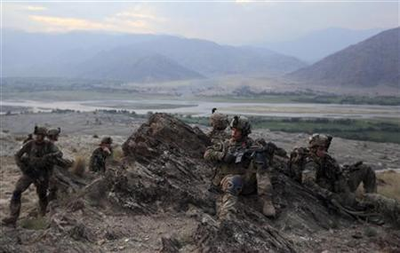 U.S. Army soldiers from Charlie Company's 2nd battalion 35th infantry regiment, Task Forces Bronco take a break during an early morning mountain patrol at the Chaw Kay district in Kunar province, eastern Afghanistan, August 19, 2011. REUTERS/Nikola Solic