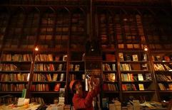 <p>A woman takes a picture in a bookstore in this file photo. REUTERS/Rafael Marchante</p>